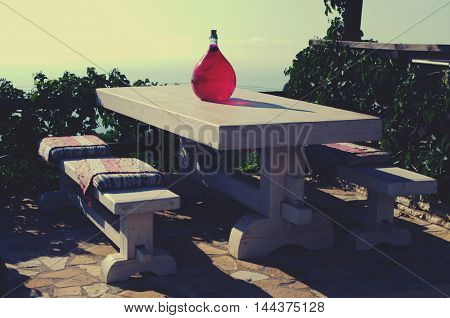 Resting place outside with table and wooden bench