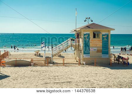 TEL AVIV, ISRAEL - JUNE 4, 2015: Building lifeguards on the beach of Tel Aviv. June 4, 2015. Tel Aviv, Israel.