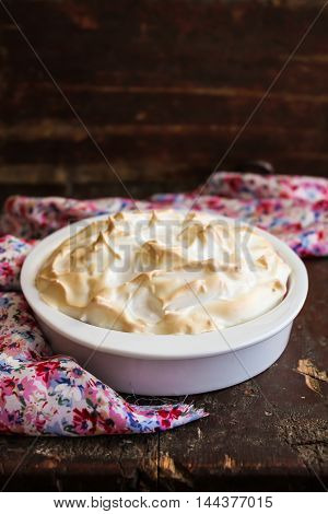 Homemade berry pie with sweet meringue in a pie dish, selective focus