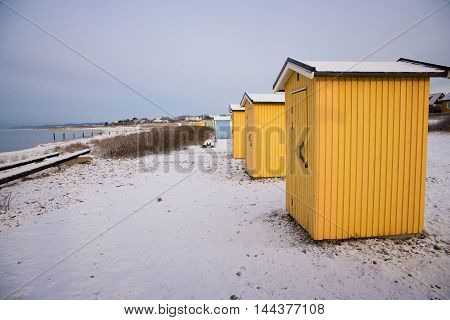 small buildings on the shore of the Strait of Oresund