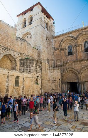 JERUSALEM, ISRAEL - JUNE 1, 2015: People at the entrance to the Church of the Holy Sepulchre.