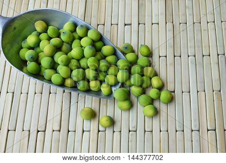 lotus seed in iron scoop on bamboo background
