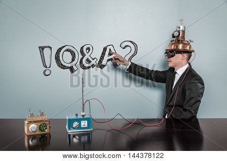 Q A concept with vintage businessman pointing hand