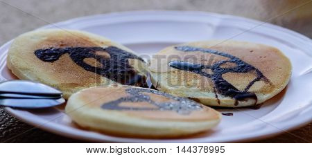 Chocolate pancakes on a brown background beautiful