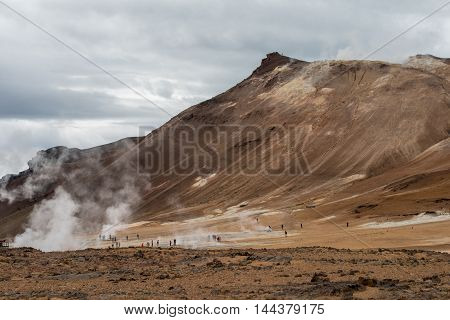 Unidentifiable tourists admire volcanic activity in Reykjahlid. Reykjahlid on the shores of Myvatn is a major tourist attraction.