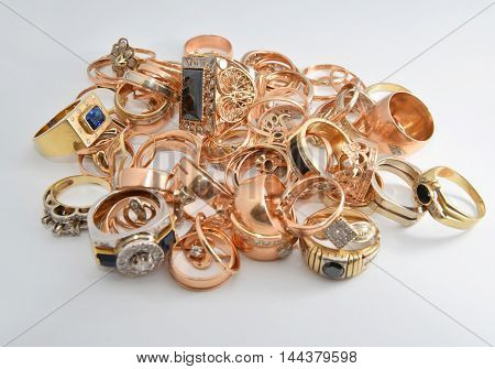 gold and silver jewelry on a light background