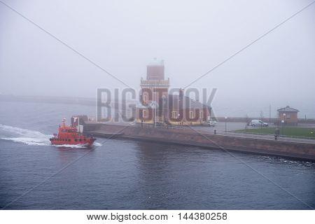 lighthouse in dense fog in Helsingborg, Sweden