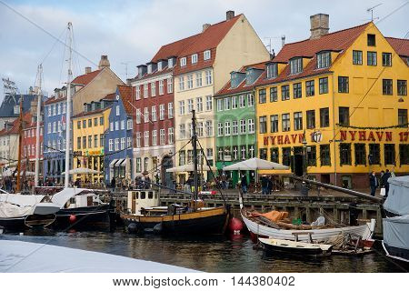 COPENHAGEN, DENMARK - 30 DECEMBER, 2014: Nyhavn is a 17th-century waterfront, canal and entertainment district in Copenhagen