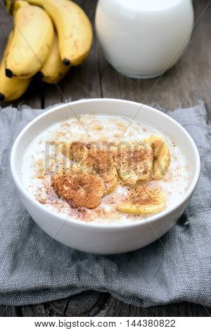 Oats porridge with banana slices healthy breakfast country style