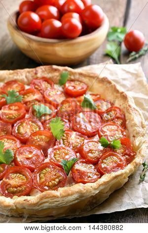 Tomato pie with herbs on baking paper