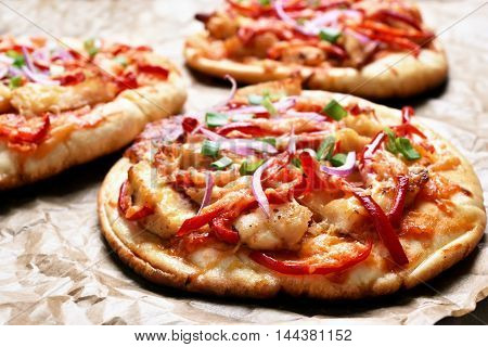 Pizza with red bell pepper onion and chicken meat
