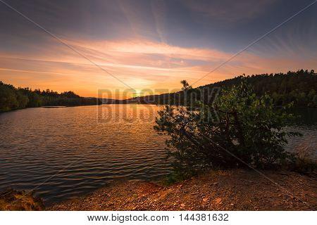 Magical sunset on the water reservoir Kretinka. Moravian landscape Letovice.