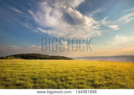 Nice view of the meadow illuminated by the sun. Moravian landscape Boskovice.