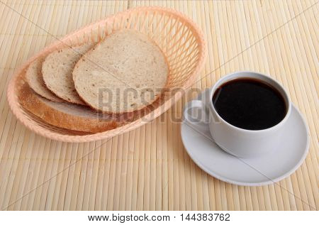 Coffee white cup  and basket on wooden table