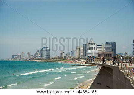 TEL AVIV, ISRAEL - JUNE 4, 2015: People relax on a beautiful beach in Tel Aviv