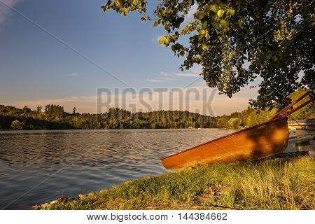 Boat on the shore near the water. Water reservoir Kretinka. Moravian landscape.