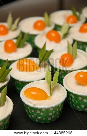 A mini cup cakes decorated coconut filling on top