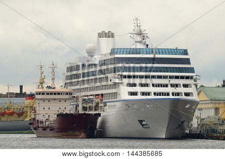 Bigbeautiful Tourist ship is moored on the waterfront.