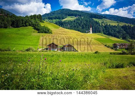 A typical mountains church placed on the hill of the valley San Candido Trentino Italy
