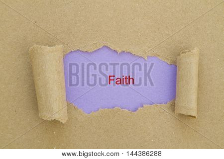 Faith word written under torn paper .