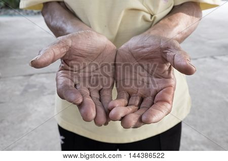old man hand begging for money. because of the hunger