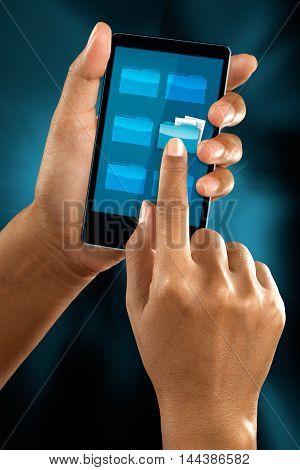 a woman finger select a folder icon on a mobile menu