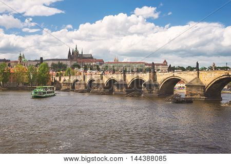 view of the Charles Bridge and St. Vitus Cathedral in Prague
