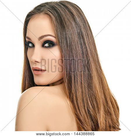 Majestic woman's beauty. Portrait of beautiful girl with healthy skin and strong brown long hair over white background. Beauty treatment, cosmetology, spa, health care, body and skin care concept.