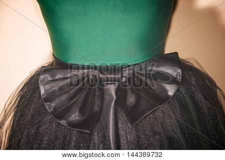 girl in a skirt with a bow