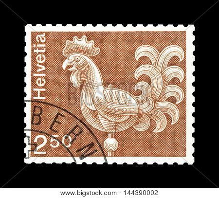 SWITZERLAND - CIRCA 1975 : Cancelled postage stamp printed by Switzerland, that shows rooster.