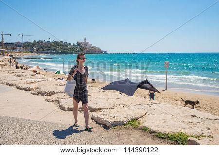 Girl walking along the promenade in Tel Aviv