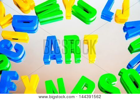 word art from plastic letters on a white background