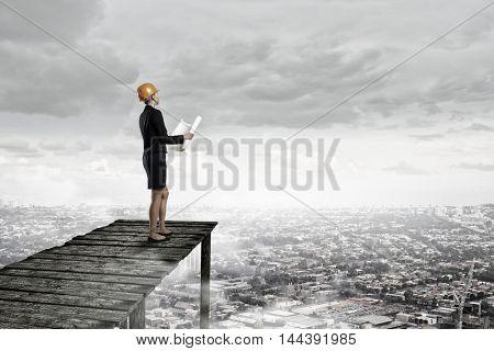 Elegant woman engineer . Mixed media