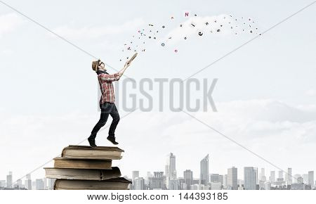 Hipster guy with book . Mixed media