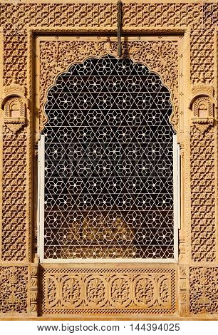 Ornate window of beautifolu Haveli in Jaisalmer city in India. Rajasthan.