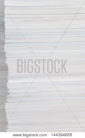 High stack of paper close-up as background