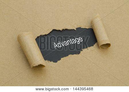 Advantage word written under torn paper .