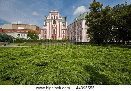 Park and baroque Catholic Church in Poznan in Poland