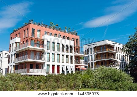 Modern townhouses with garden seen in Berlin, Germany