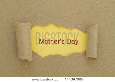 Mother's Day written under torn paper .