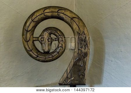 OSLO, NORWAY - JULY 1, 2016: It is ancient carved decoration in the form of the head of the snake from Viking Ship Museum.