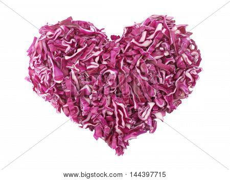 Shredded raw red cabbage in a heart shape isolated on a white background