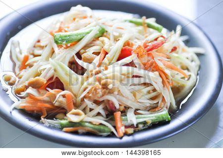 spicy salad SOM TAM or Thai spicy salad