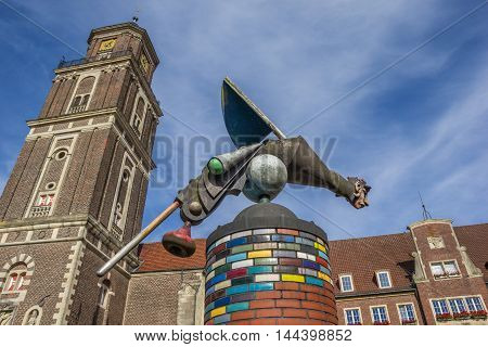 Sculpture And Church Tower In Coesfeld