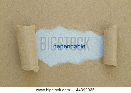Dependable word written under torn paper .