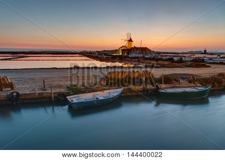 Sunset at the saltpans of Marsala in Sicily