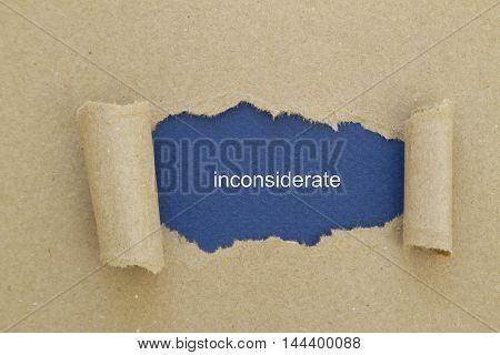 inconsiderate word written under torn paper .