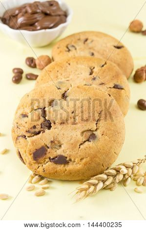 Chocolate chip cookies and cream on yellow background