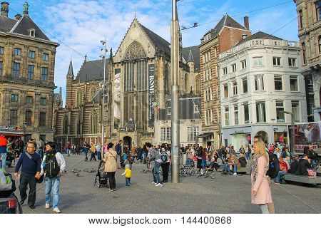 Amsterdam the Netherlands -October 03 2015: Tourists walking on Dam Square in historic city centre