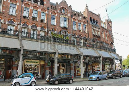 Amsterdam the Netherlands -October 03 2015: People on the picturesque street in historic centre